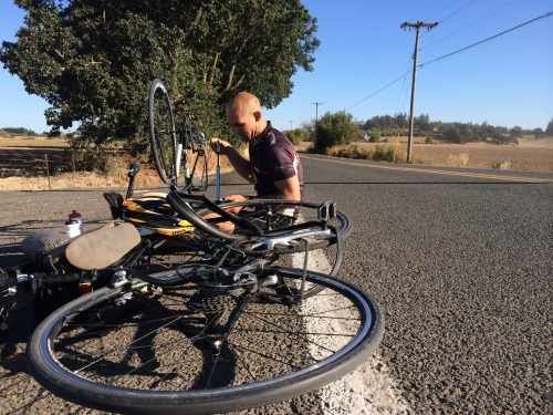 Fixing the many flats on day 1 of Oregon Bike Tour